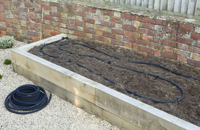 irrigation soaker hose in raised bed